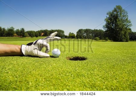 Golf club: golfer concentrating on the 18th hole poster