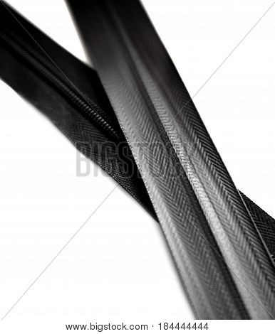 Black waterproof zipper isolated on white background