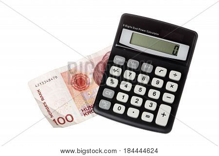 One black pocket calculator on a Norwegian one hundred krona banknote isolated on white background.