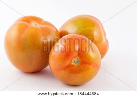 Tomato ( Lycopersicon esculentum) isolated in white background
