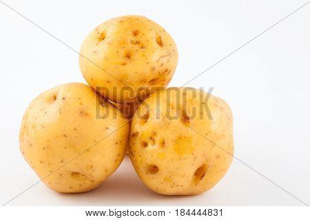 Yellow potato (Solanum phureja) isolated in white background