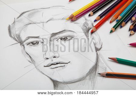 Drawn portrait of a man in black and white with colorful pencils