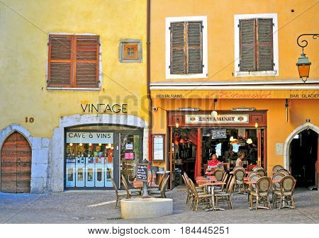 ANNECY FRANCE - AUGUST 22 2015: Facade of a french restaurant in old town of Annecy on August 22 2015. Annecy is a capital of Haute Savoie province France.