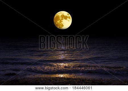 Landscape moon over horizon on sea and moonlight.  Panorama with the luna of night. Grand mystical fantastic view.