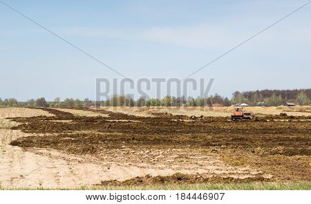 tractor preparing land with seedbed cultivator in early spring season of agricultural