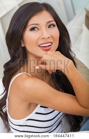 Portrait of a beautiful Chinese Asian young woman or girl smiling with perfect teeth