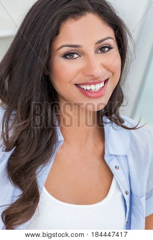 Portrait of a beautiful young Latina Hispanic woman smiling with perfect teeth