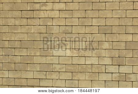 Beige brick background/ This is a wall from beige bricks.