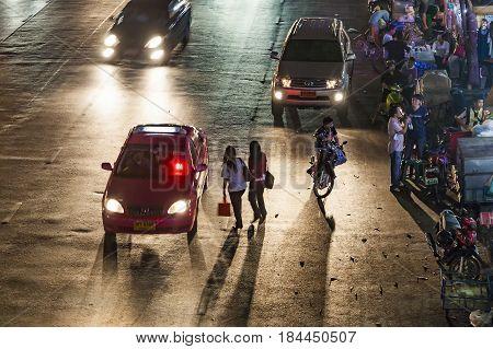 Women Cross The Road By Night