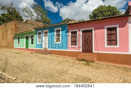 Colorful houses on the cobblestone streets in the UNESCO World Heritage city center of Trinidad Cuba.