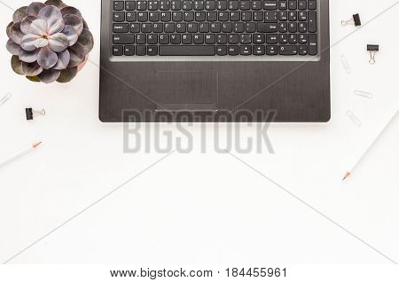 Business Workspace Desk With Laptop, Clips, Succulent, Pencils On White Background. Flat Lay.