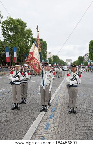 Paris. France. July 14 2012. Legionnaires of the French foreign legion with a pennant during the parade on the Champs Elysees in Paris.