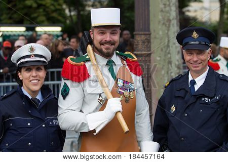 Paris. France. July 14 2012. A legionary pioneer of the French foreign legion with representatives of the police before the parade on the Champs Elysees in Paris.