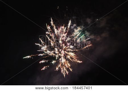 Bright beautiful colorful firework. Colored firework lights in the night sky. New Year holiday firework. Festive firework. Firework concept. Firework night. Great firework. Firework at party