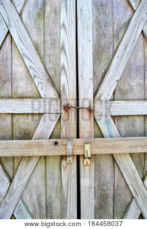 Close up of metal locks on barn doors.