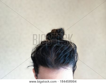 Head of female with dirty greasy hair