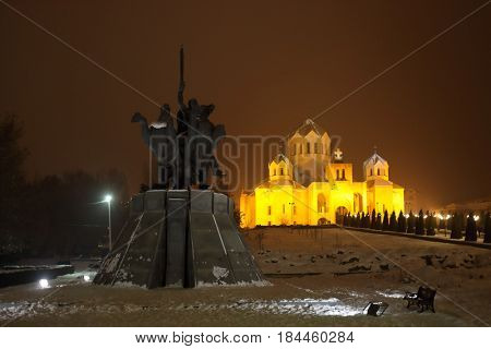 YEREVAN, ARMENIA - JAN 5, 2017: Horse Monument to Andranik Ozanian, Cathedral of St. Gregory Illuminator at night