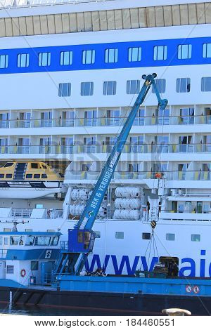 IJmuiden the Netherlands -April 29th 2017: Aida Luna docked at Felison Cruise Terminal IJmuiden collecting garbage with service vessel
