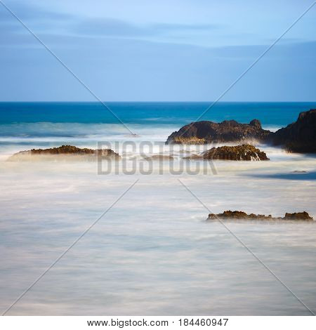 Los Hervideros, Volcanic Coastline With Wavy Ocean And Blue Sky, Long Time Exposure