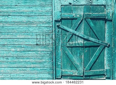 Closed shutters of old wooden house window with copy space