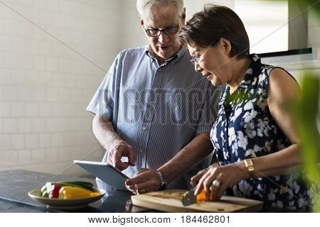 Senior Couple Cooking Food Kitchen