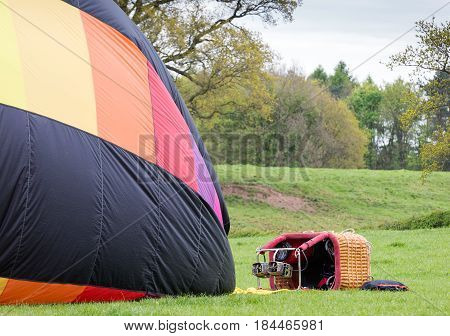 Hot air balloon lying on its side soon after landing