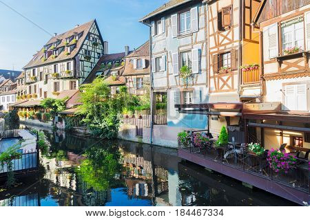 half timbered crooked houses of Colmar with reflections, Alsace, France