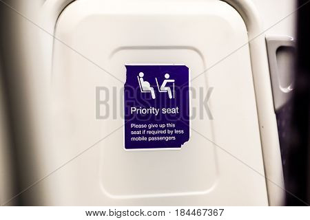 Priority seats sign to Seat of an airplane