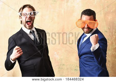 Businessmen In Suits And Funny Glasses Celebrating Deal Conclusion