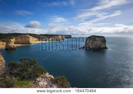Stretch of the Algarve coastline and beaches from the Ponta do Altar promontory in Ferragudo Algarve Portugal; Concept for travel in Portugal and Algarve