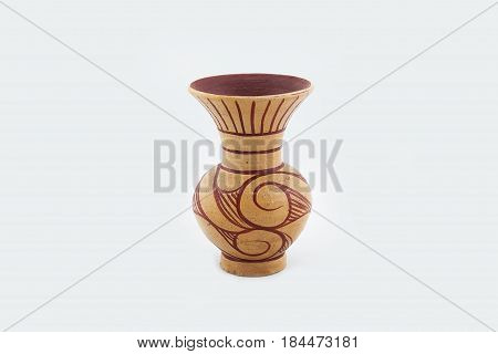 Orange clay ceramic pot, shaped rounder at the bottom, and more narrow at the top. Isolated on white background