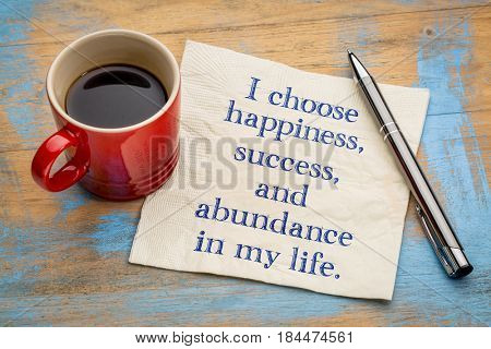 I choose happiness, success and abundance in my life - inspirational handwriting on a napkin with a cup of coffee