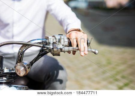 Man Riding Motorcycle, Close Up Of Hand On Handlebar