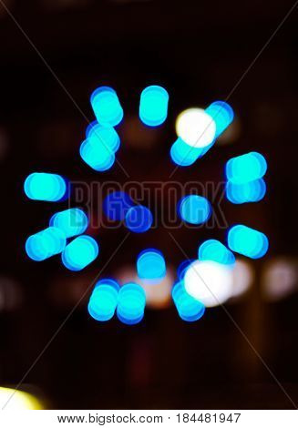 Defocused abstract multicolored bokeh lights background. Colourful festive multi colored circles