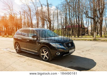 Smolensk, Russia - April 24, 2017: New Nissan Pathfinder parked in suburbia street of Smolensk City.