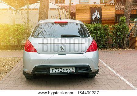 Smolensk, Russia - April 25, 2017: New Peugeot 308 parked near hotel in sunlight.
