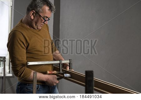Carpenter Using Screw Clamp
