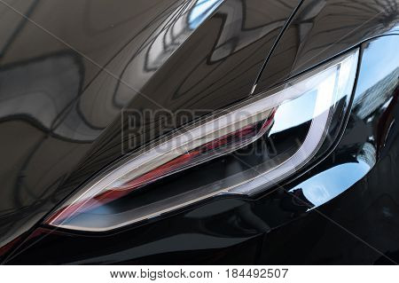 Headlight lamp of new cars. Sport car concept.