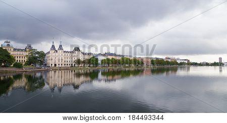 Waterfront city buildings along the canal in Copenhagen Denmark. Copenhagen city panorama in summer.