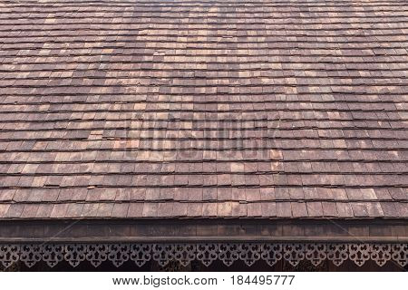 old clay roof tiles with wood eave perforated design