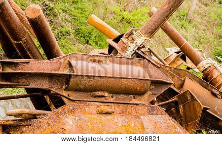 Closeup of large rusted metal anchor used on large fishing vessels