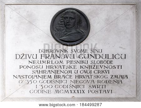DUBROVNIK, CROATIA - NOVEMBER 08: Memorial Plaque to Ivan Gundulic buried in the Franciscan church of the Friars Minor in Dubrovnik, November 08, 2016.