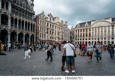 Brussels Belgium - July 30 2016: Crowd of tourists in The Grand Place of Brussels. The square is the most important tourist destination in Brussels and it is a UNESCO World Heritage Site