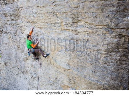 Climber Climbs The Rock..