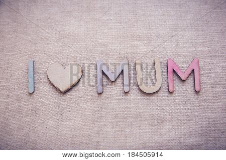 I love mum made from wooden letters and heart shape wood toning