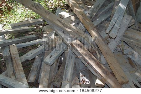 Pile of used sawn timber collected for reuse.