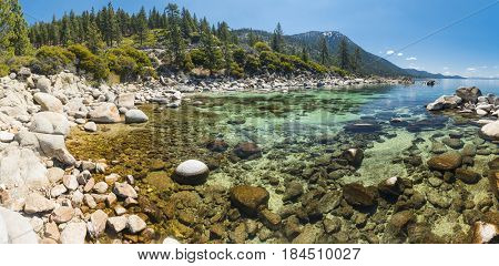 Beautiful boulders and crystal clear water of the lake Tahoe. Hidden Beach, Lake Tahoe - Nevada, USA. Panoramic photo