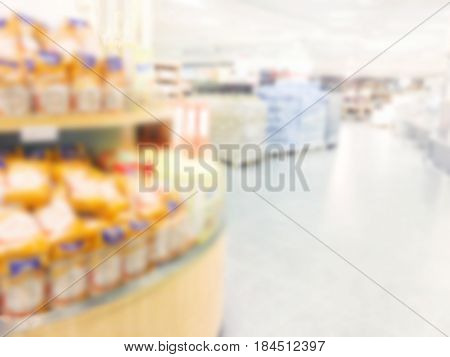Supermarket store blur background with aisle colorful shelves and defocused effect