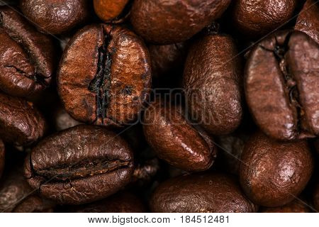 Dark Roasted Coffee Beans Caffeine Brown Espresso wall paper close up. Fried Coffee Beans Texture macro