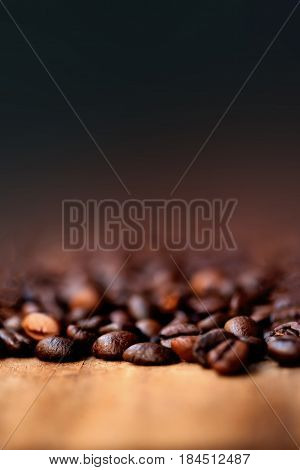 Coffee Beans Caffeine Roasted Brown Espresso wall paper with copy space close up. Fried Coffee Beans Texture macro